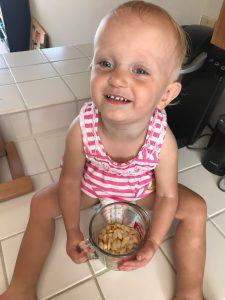 Little Zoe helping to make pumpkin seeds